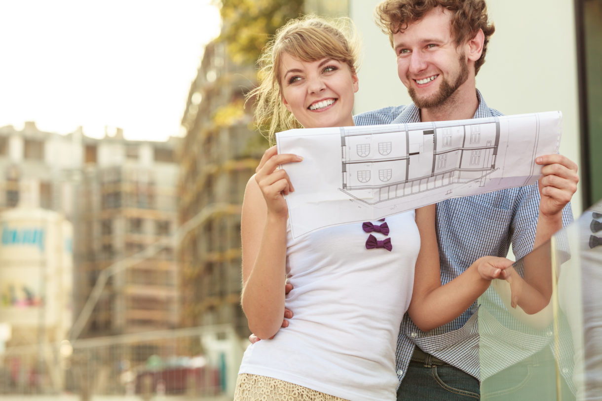 couple with blueprint project outdoor